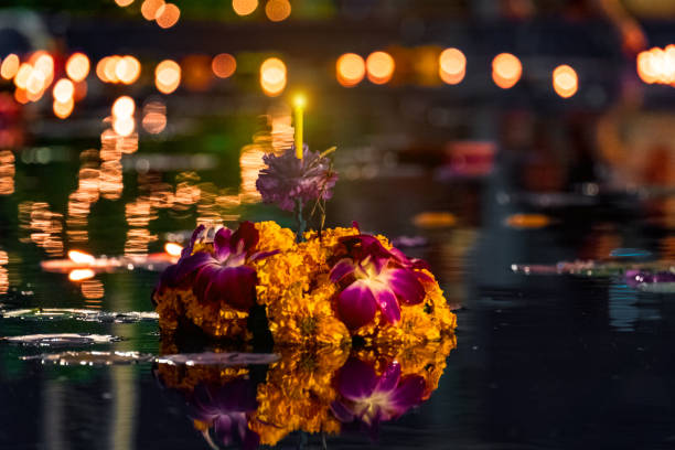 Candle and flower, Loy Krathong Festival, Thailand. stock photo