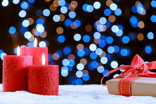 Candle And Gift Over Snow For Christmas Stock Photo - Download Image Now