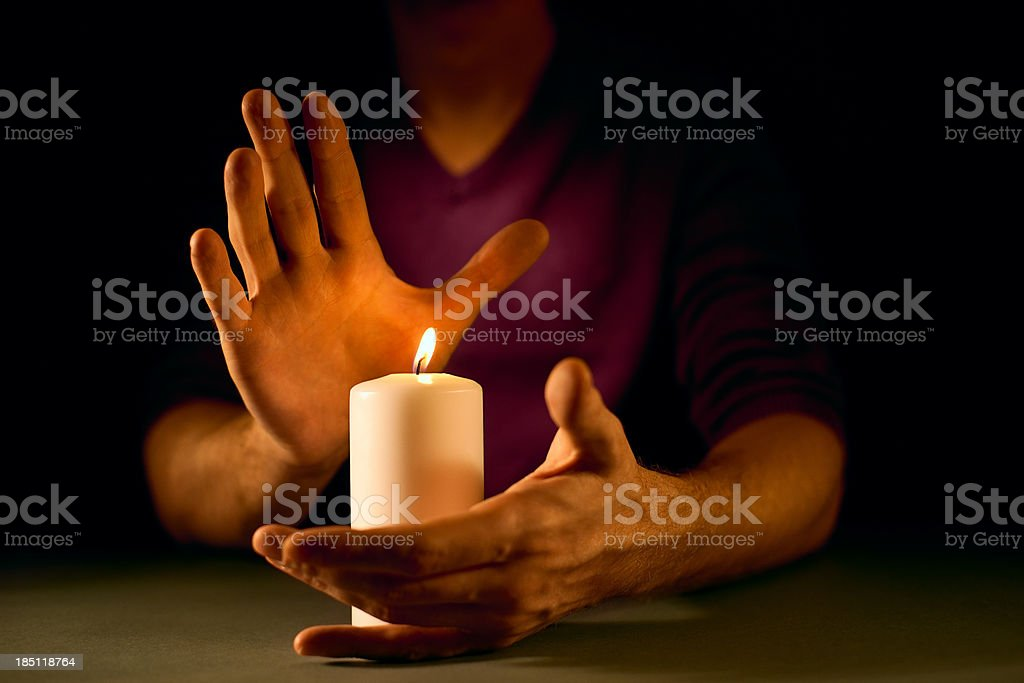 Candle and hands royalty-free stock photo