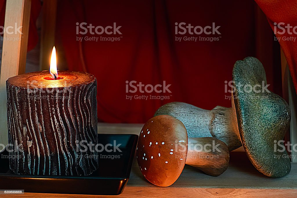 Candle and mushrooms under stairs royalty-free stock photo