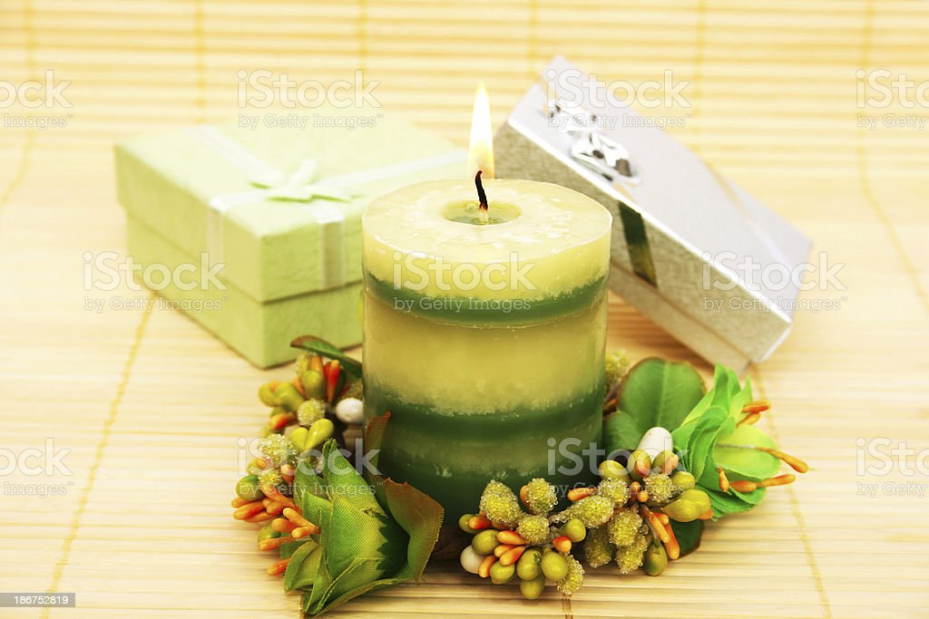 Candle and present boxes royalty-free stock photo