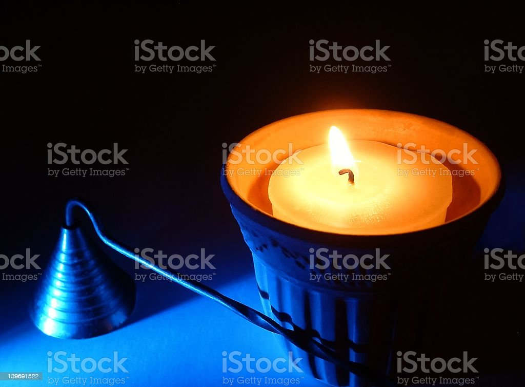 Candle and Snuffer stock photo