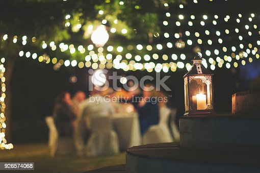 istock Candle and string lights outdoor dinner 926574068