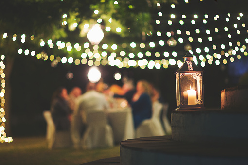 Candle and string lights outdoor dinner