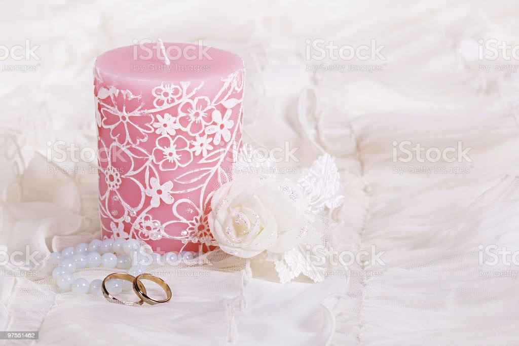 Candle and wedding rings royalty-free stock photo