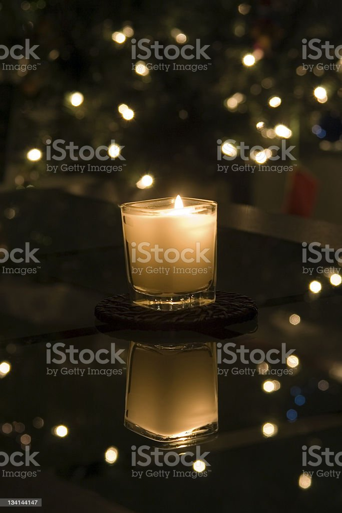 A Candle at Christmas stock photo
