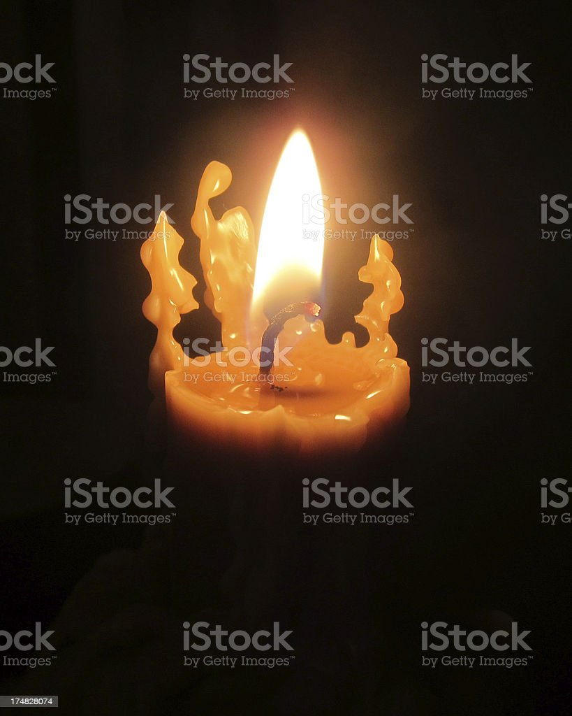 Candle Flame Against A Black Background royalty-free stock photo
