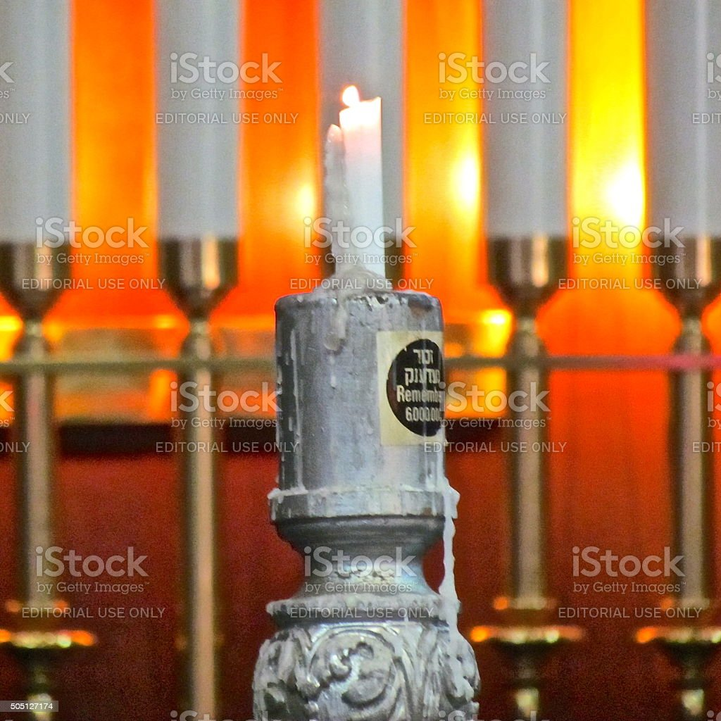 Candle flame following Holocaust Memorial Yom HaShoah candle lighting ceremony stock photo