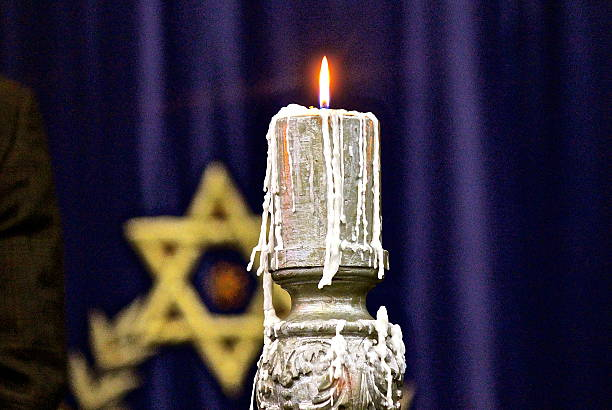 Candle flame following Yom HaShoah Holocaust Memorial candle lighting ceremony stock photo
