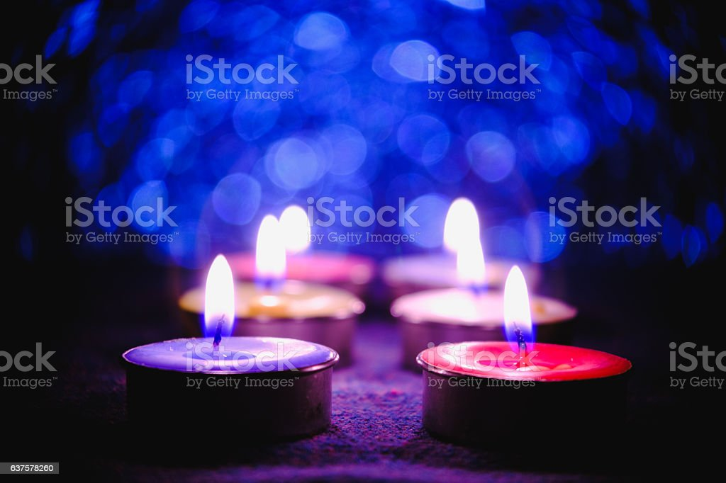 Candle flame light at night. stock photo