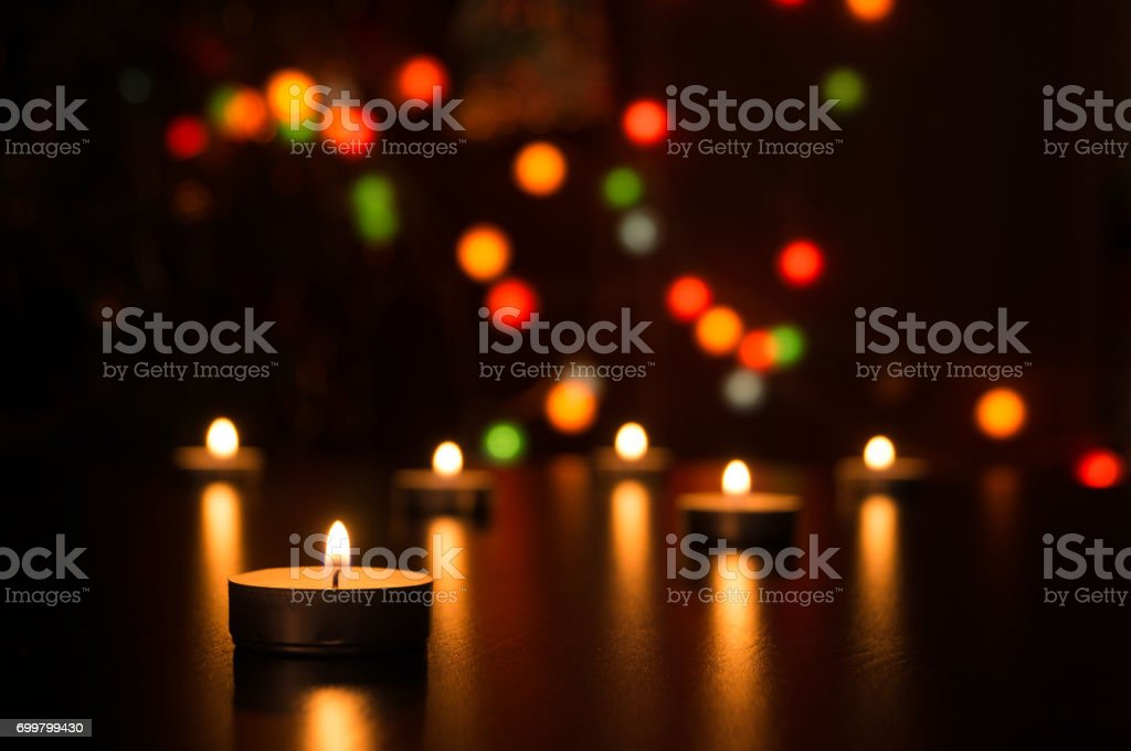 candle flame light at night with bokeh on dark background. Candles with light in a romantic decoration and defocused lights. Bokeh stock photo