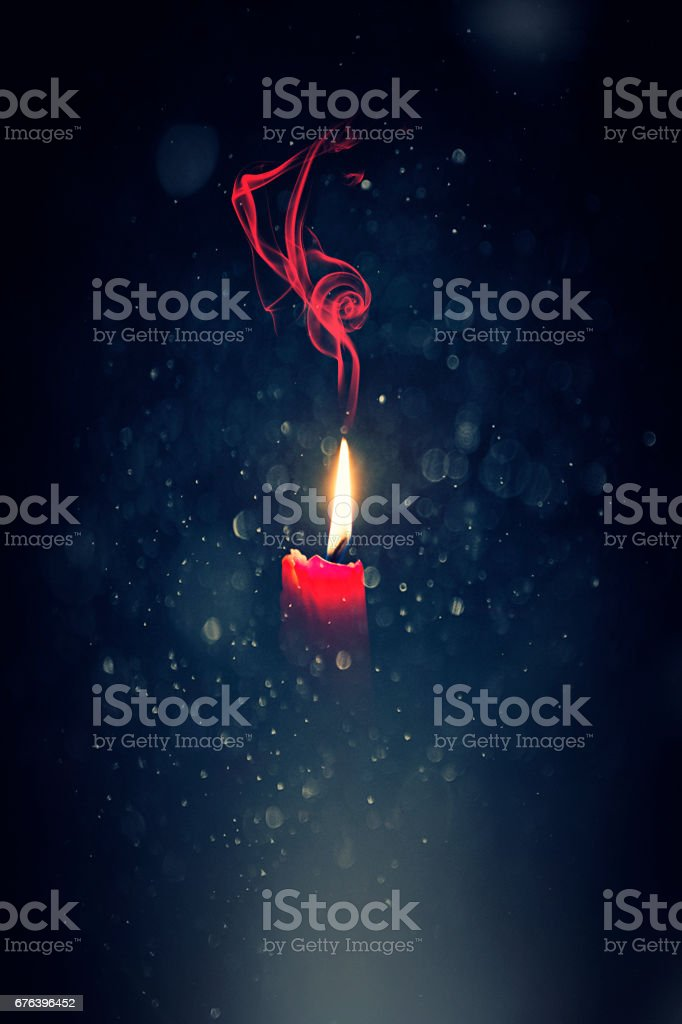Candle flame light at night with bokeh stock photo