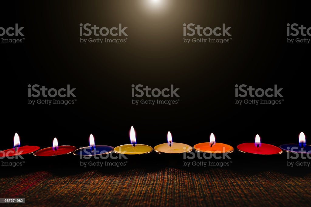 Candle flame light at night with night background. stock photo