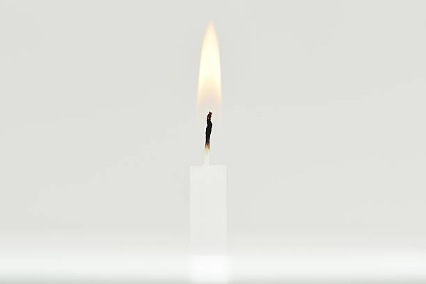 Candle flame on white background. stock photo