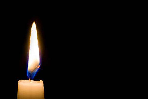 Candle flame with black background stock photo