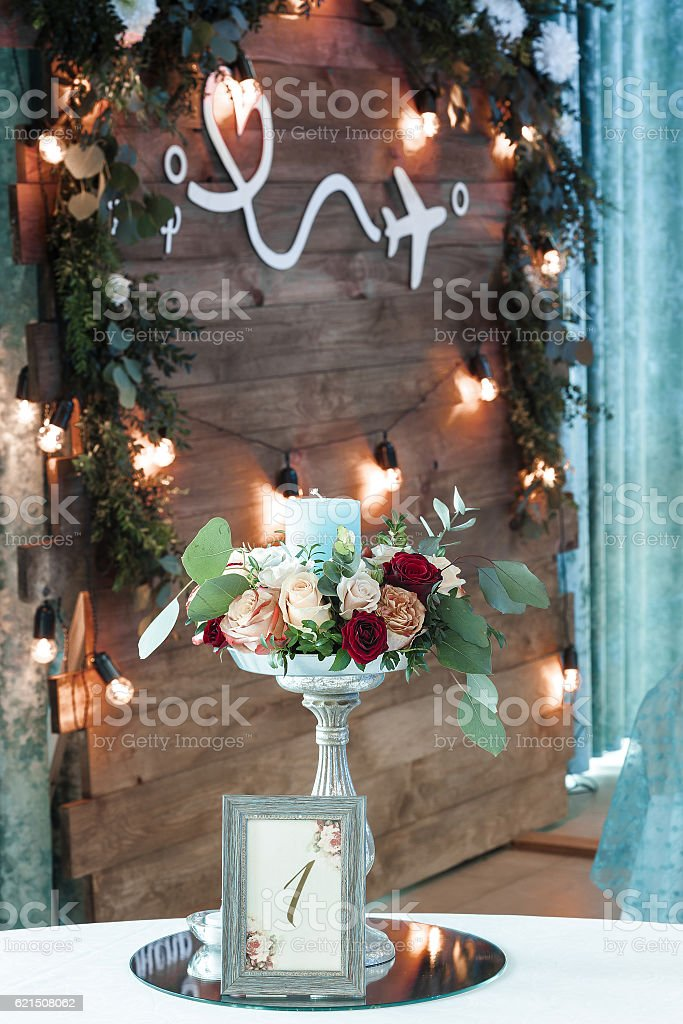 candle holder with a  and  bouquet of roses Lizenzfreies stock-foto