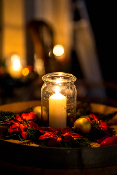 Candle in a glass burns in the dark stock photo