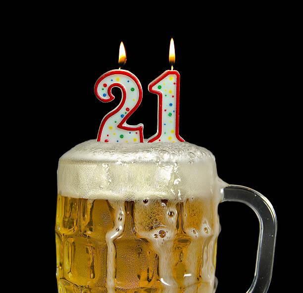 candle in beer for 21st birthday - 20 24 yaş stok fotoğraflar ve resimler