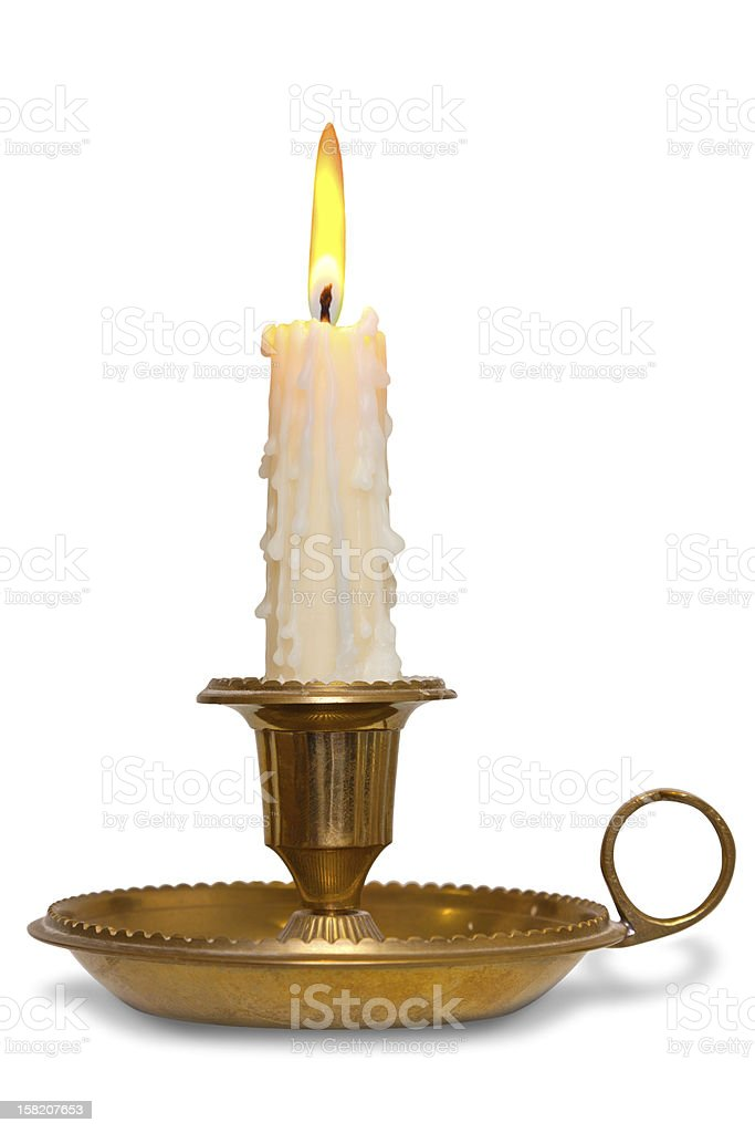 Candle in brass holder isolated stock photo