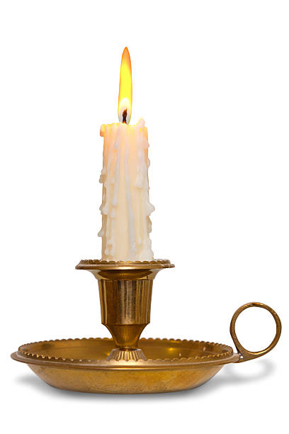 candle in brass holder isolated - kandelaar stockfoto's en -beelden