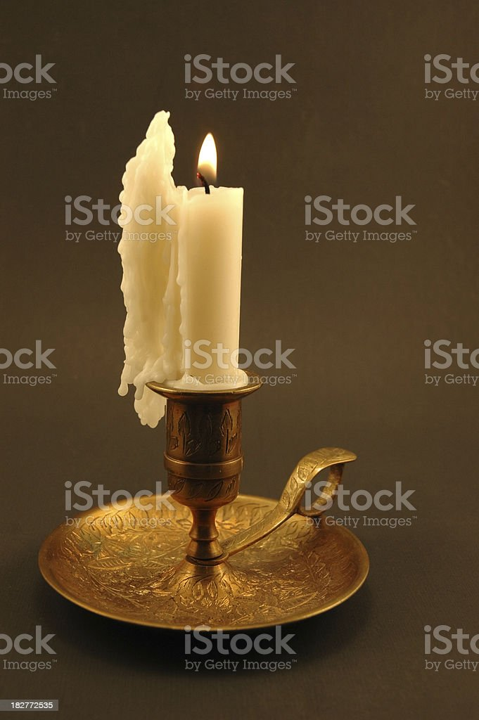 Candle in Brass stock photo