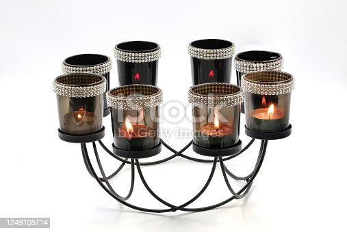 860389678 istock photo candle in glass cup 1249105714