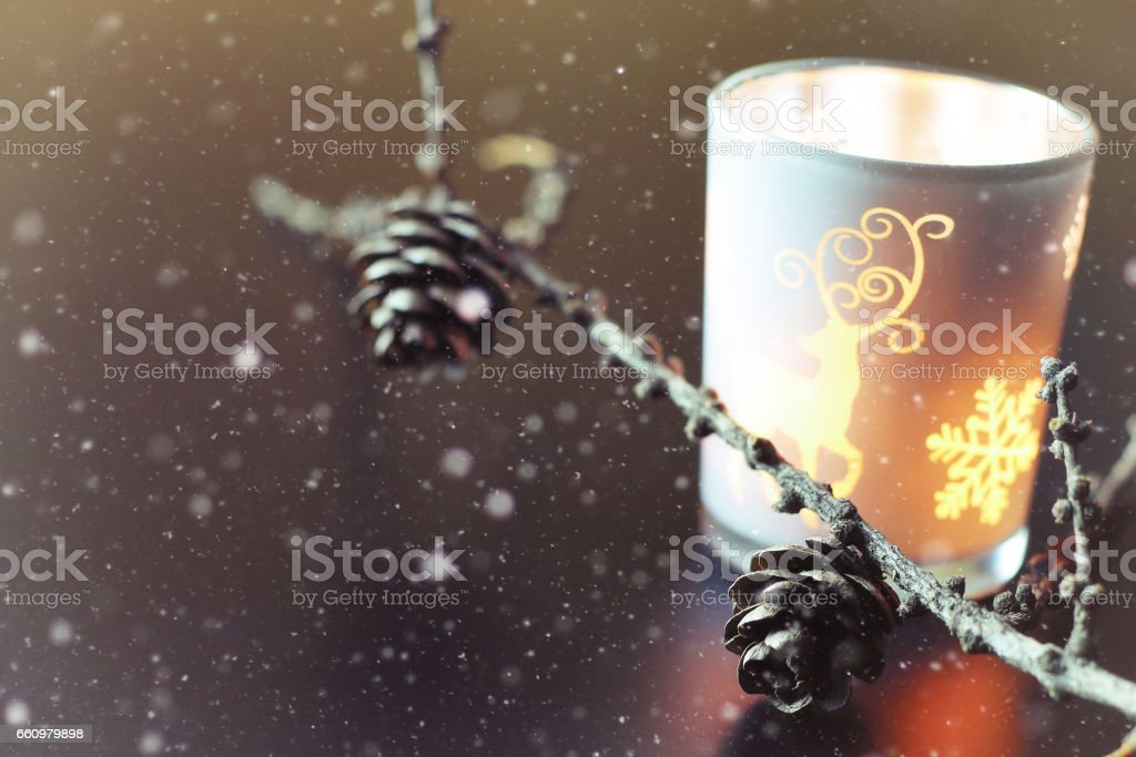 candle in glass fir-cone stock photo