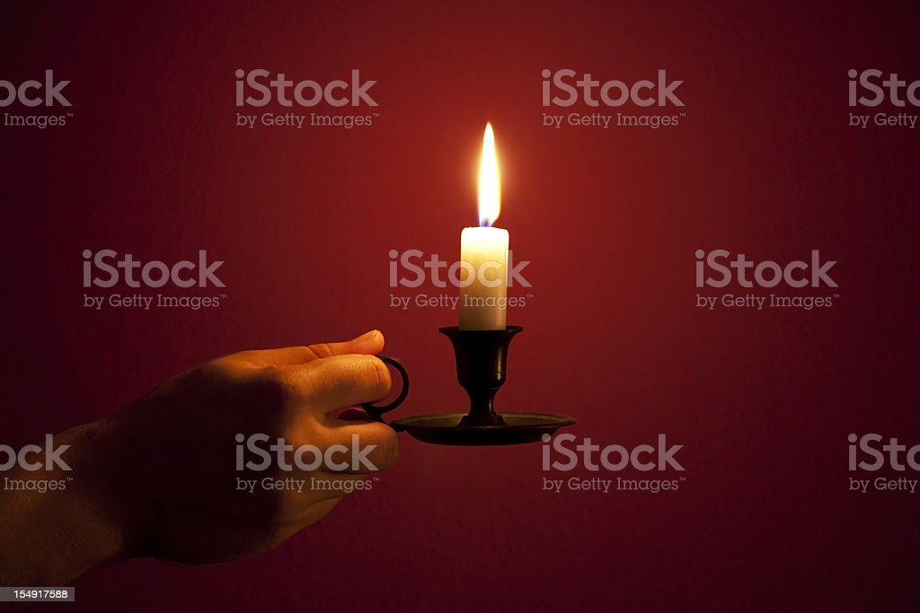 candle in hand royalty-free stock photo