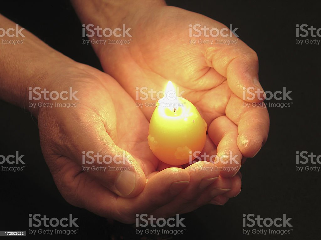 Candle in hands royalty-free stock photo