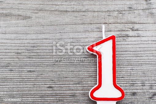 istock Candle in shape of number 1 1028368452