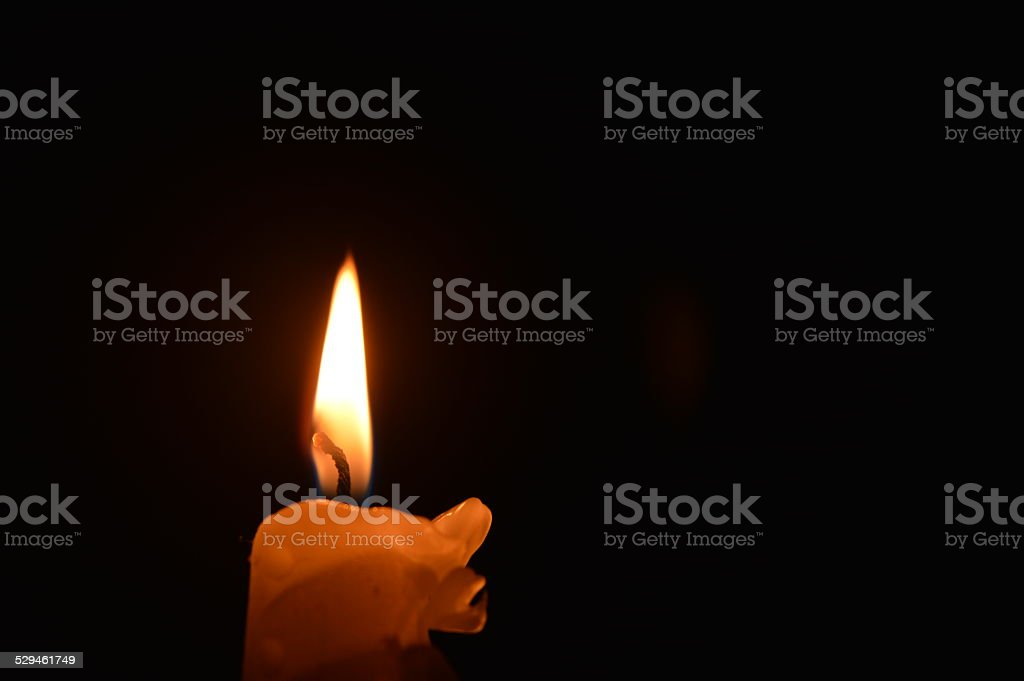 Candle in the dark - Stock Image stock photo