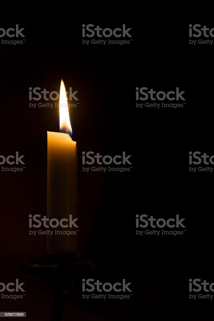Candle in the Darkness stock photo