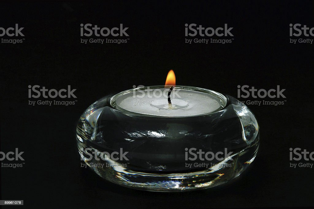 Candle in transparent glass vase royalty-free stock photo