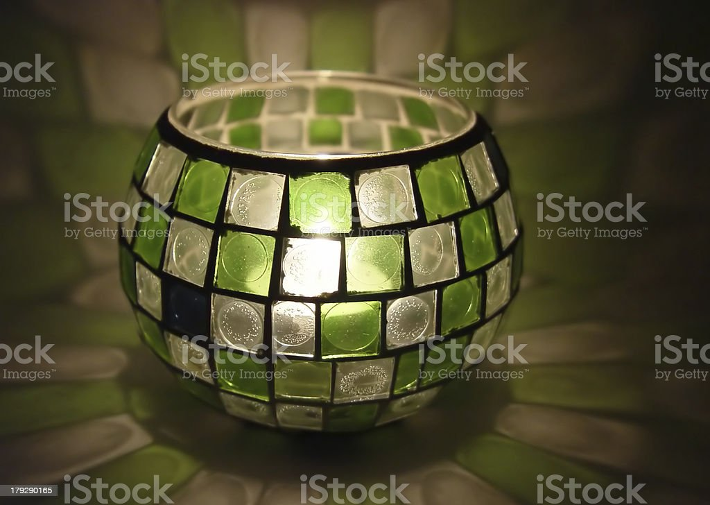candle inside a stained glass royalty-free stock photo