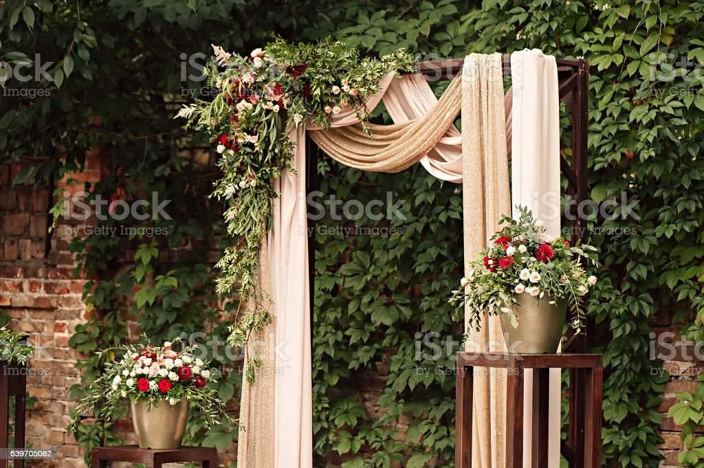 Candle lamp with a bouquet of red and white flowers. stock photo