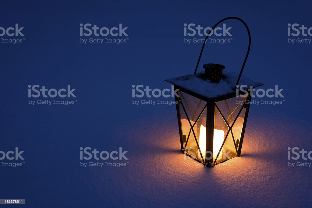 Candle Lantern in Snow royalty-free stock photo