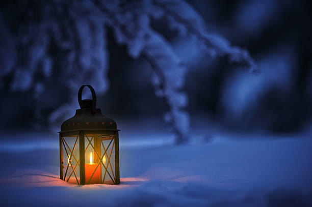Candle lantern in snow Candle lantern in snow lantern stock pictures, royalty-free photos & images
