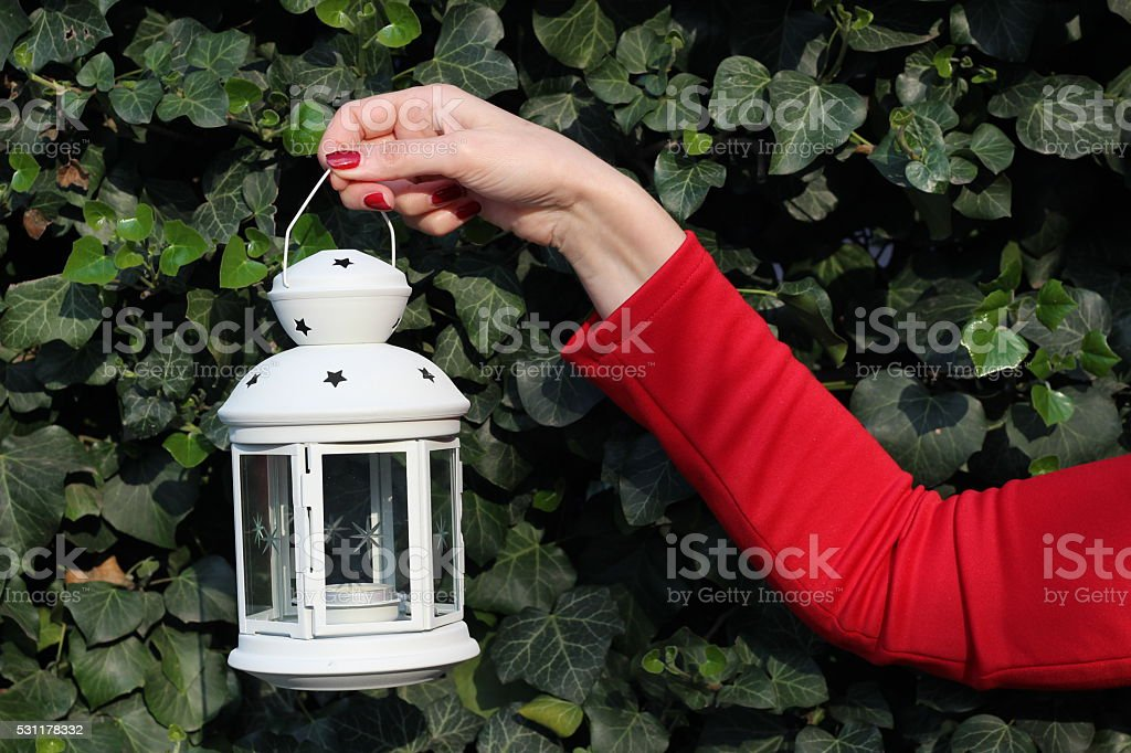 Candle lantern lamp in the hand of girl stock photo