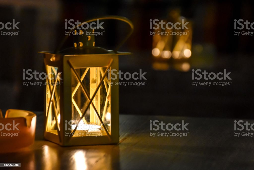 Candle lanterns on restaurant tables stock photo