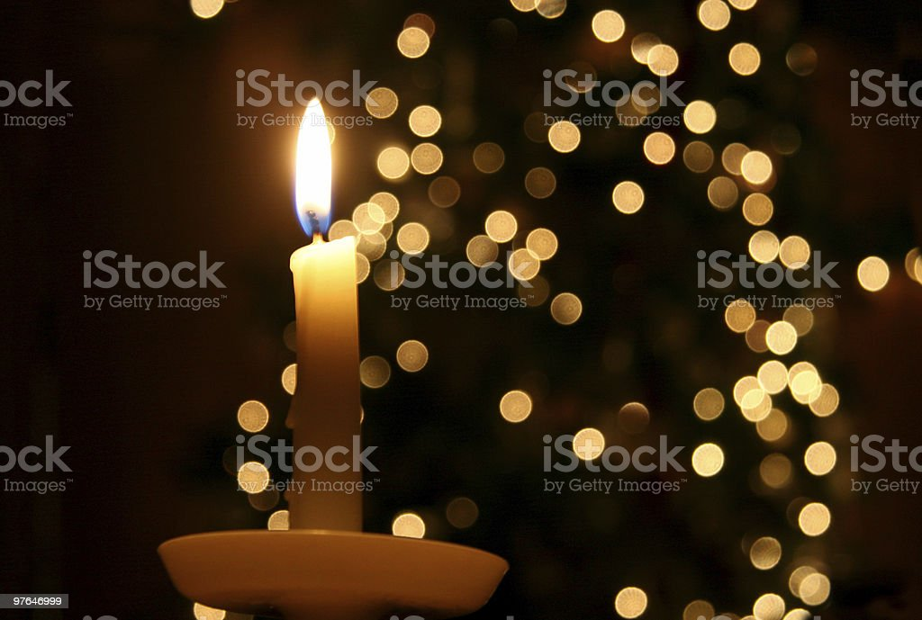 Candle light and a Christmas tree stock photo
