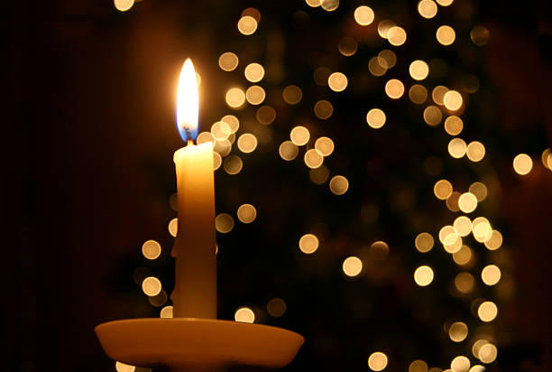 candle light and a christmas tree - candlelight stock pictures, royalty-free photos & images