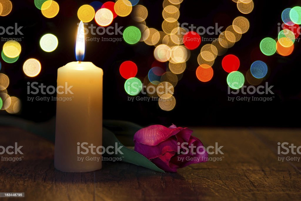 Candle light closeup with bokeh and flower royalty-free stock photo