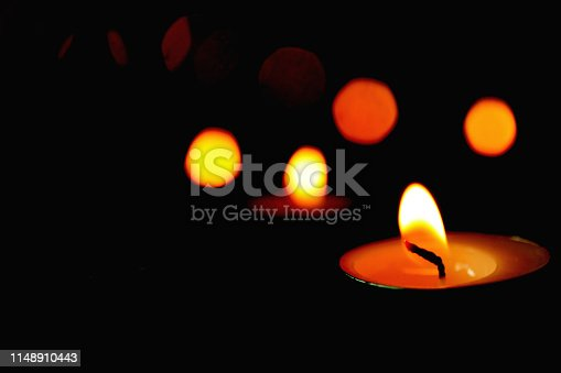 Candle light and light bokeh with  dark black background.