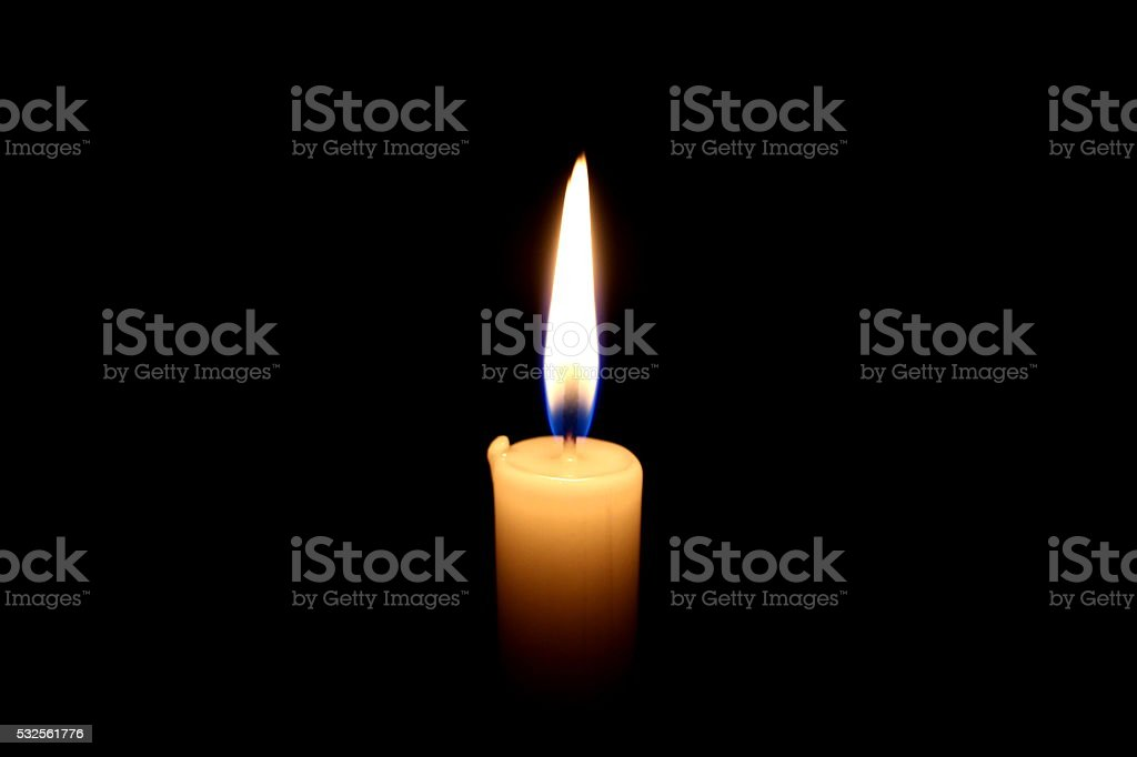 candle light on black background stock photo
