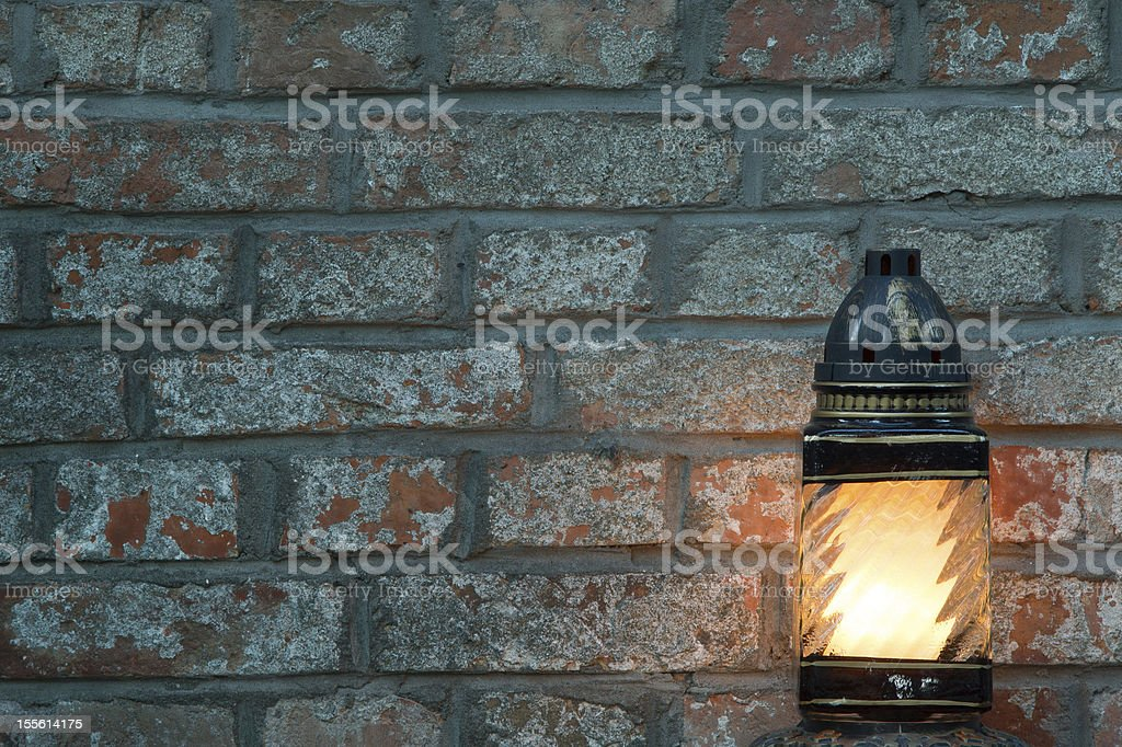 candle on a brick background with text space royalty-free stock photo