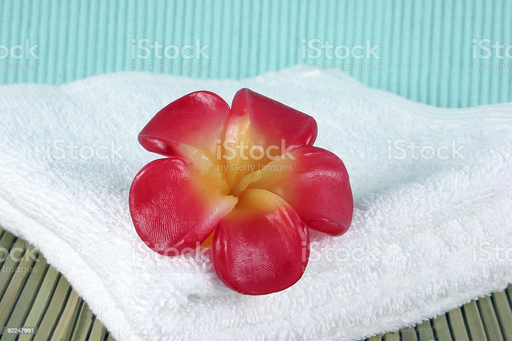 Candle on a white towel - spa products royalty-free stock photo