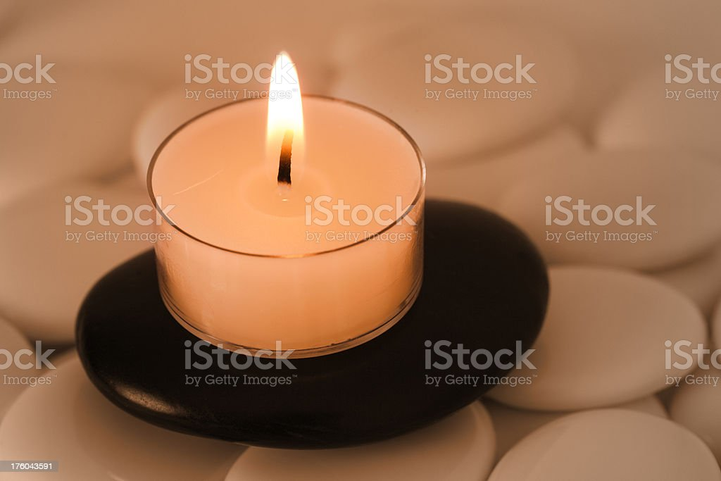 Candle on Pebbles royalty-free stock photo