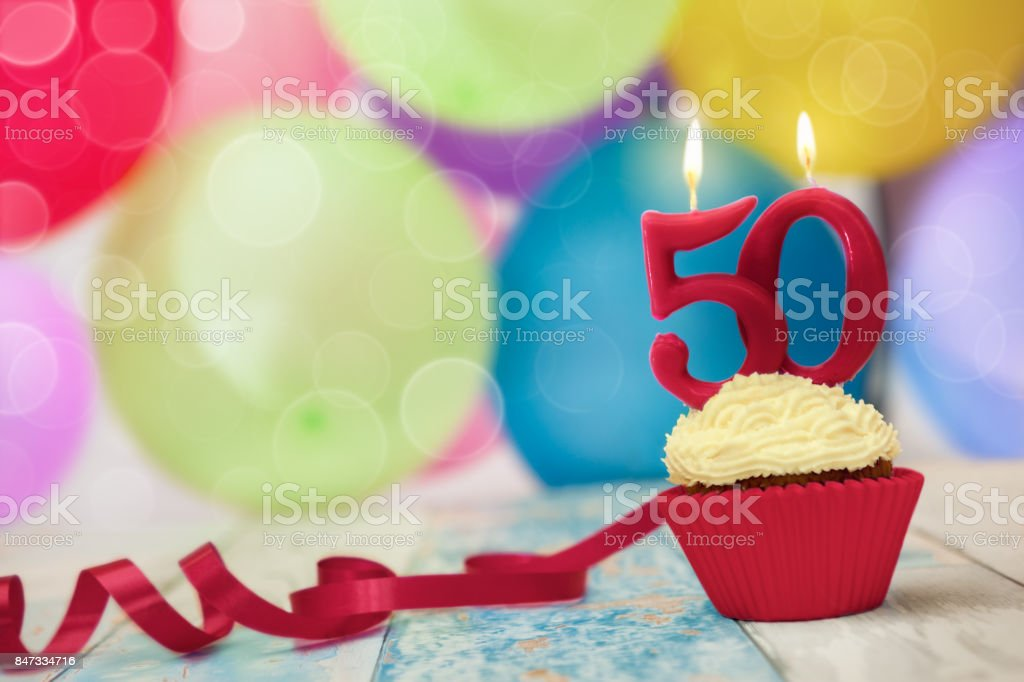 Candle on top of birthday cupcake stock photo
