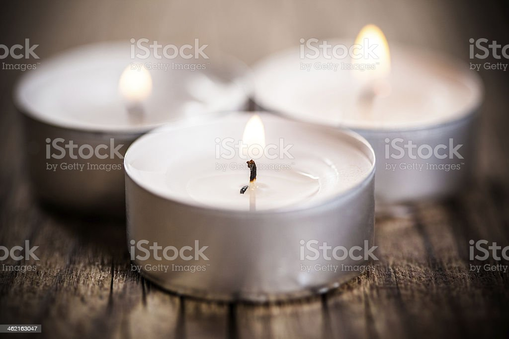 Candle on wooden background stock photo