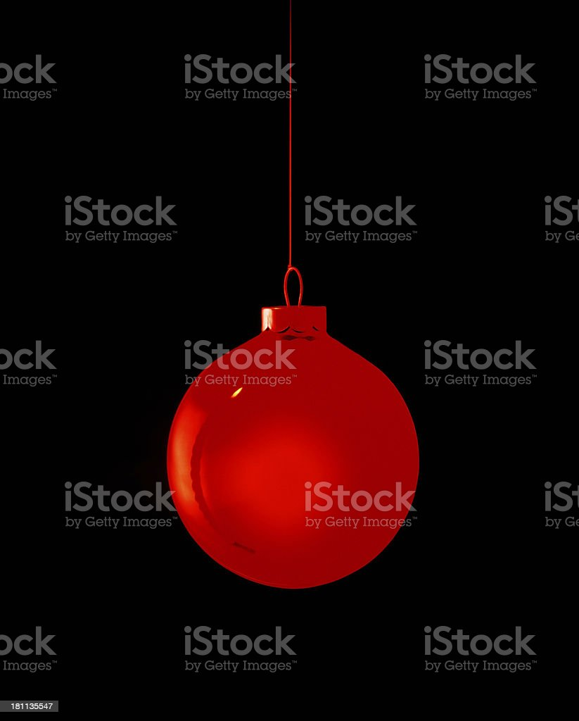 Candle reflected in a Christmas ball against black background. royalty-free stock photo